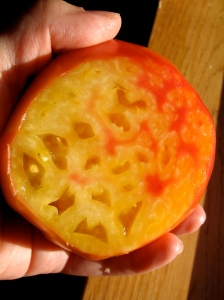 The inside of a German Striped Heirloom Tomato